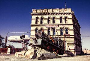 steampunk train and victorian architecture